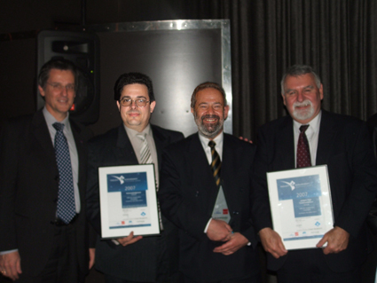 Receiving AIPM award L-R Peter Scuderi (Chief Operating Officer, CRC for Construction Innovation), Dean Cipolla (Group Safety Manager, John Holland Group), Don Dingsdag (Senior Lecturer/Consultant, The University of Western Sydney), Herbert Biggs (Associate Professor, QUT)<